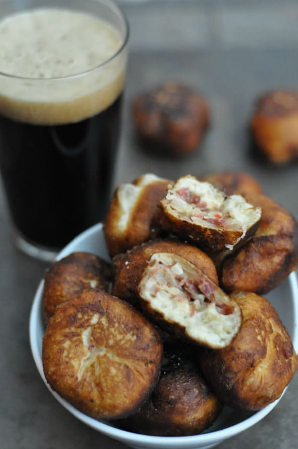 Reuben Donuts made with cooked corned beef, sauerkraut, swiss cheese and Thousand Island dressing tucked inside biscuit dough and deep fried. Recipe here: http://diningwithalice.com/appetizers/reuben-donuts/