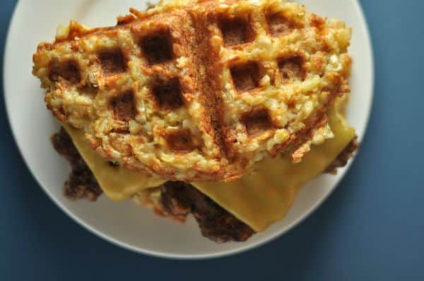 Tater Tot Waffles recipe makes a savory waffle perfect for a burger, grilled cheese or eggs. Only three ingredients and made on your waffle iron. http://diningwithalice.com/comfort-foods/tater-tot-waffles/