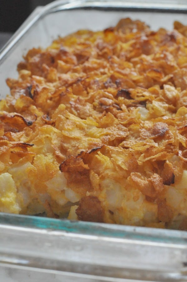 Holiday Classic! Corn Flakes Potato Cheesy Casserole recipe made with cubed hash browns, cheese and sour cream. Super simple and a hit for holiday meals!