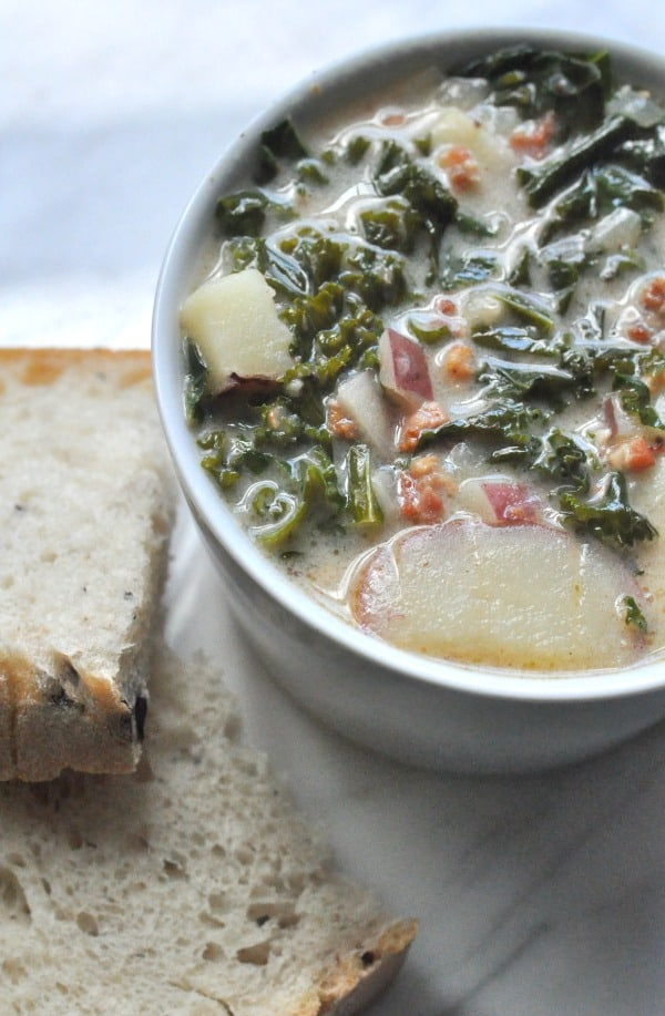 This Sausage and Kale Soup is an Olive Garden Zuppa Toscana copycat recipe made with bacon, Italian sausage, potatoes and fresh kale. http://diningwithalice.com/soup/sausage-and-kale-soup/ ‎