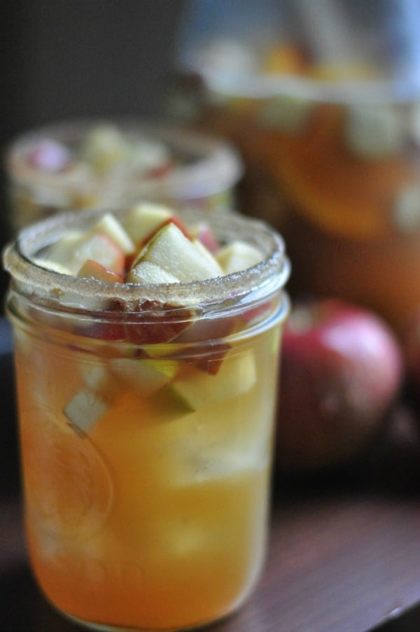 Super easy apple cider sangria made with sparkling wine and bourbon soaked apples and pears. Fall cocktail: http://diningwithalice.com/drinks/apple-cider-sangria-with-bourbon/
