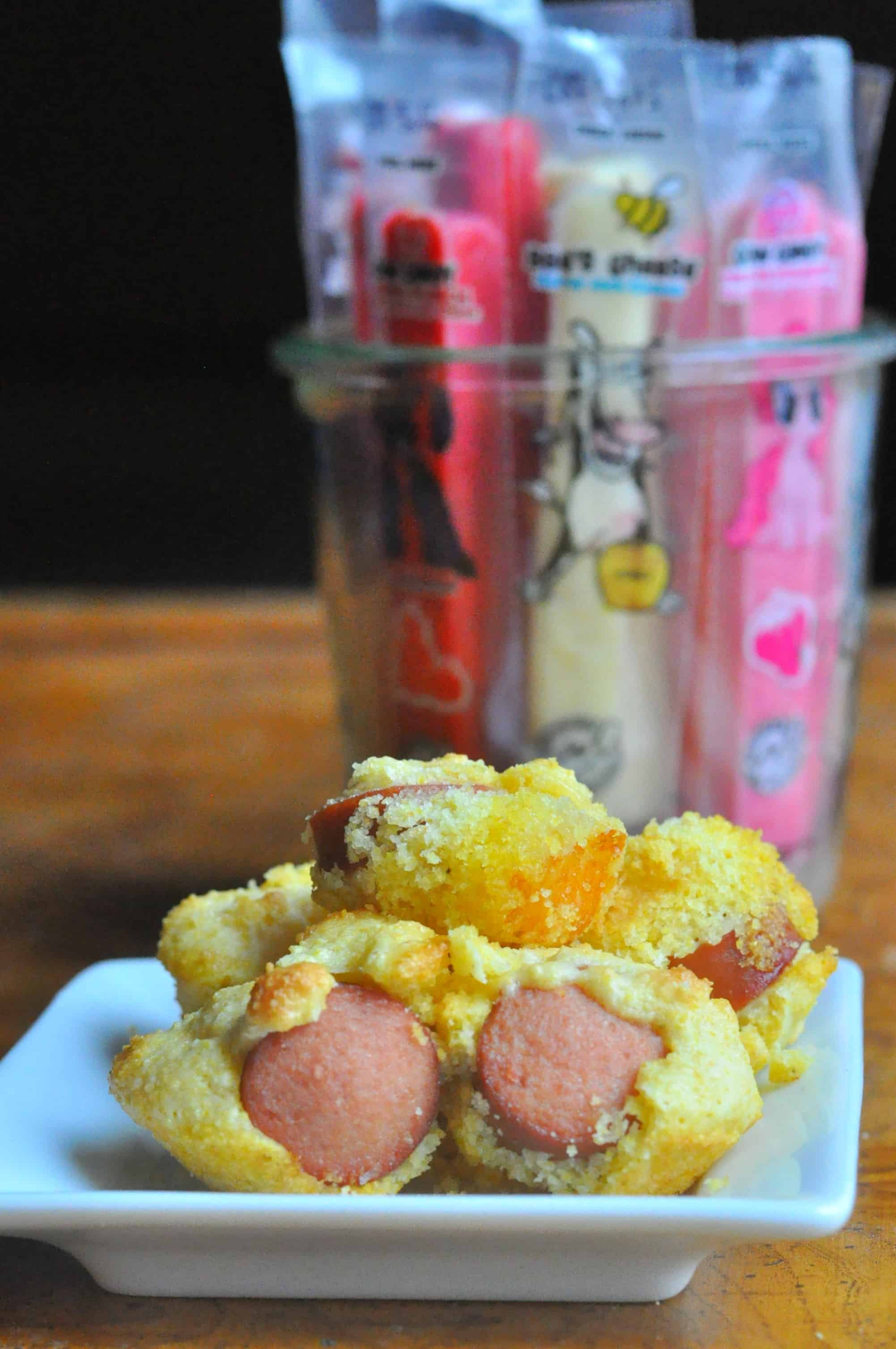 Cheesy Mini Corn Dog Muffins Cow Candy Easy Kids Recipe A super easy Cheesy Mini Corn Dog Muffins recipe that makes a great weeknight meal, fun school lunch, or game day appetizer. http://diningwithalice.com/kids/cheesy-mini-corn-dog-muffins/
