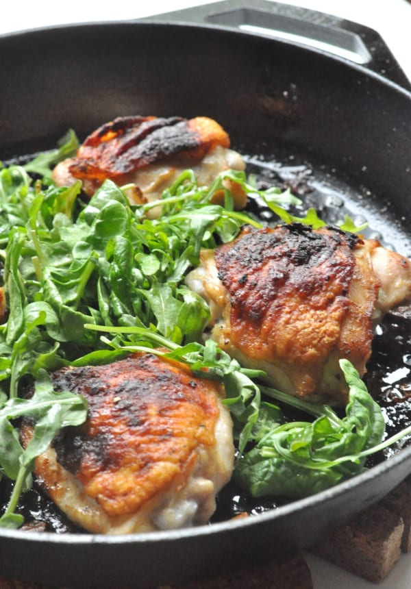 Keto Chicken Thighs recipe in a cast iron skillet flavored with ranch and sautéed with garlic.