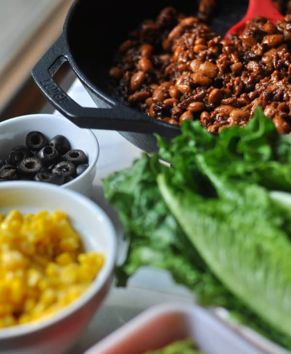 This easy Taco Salad is a quick recipe and is layered with Doritos, ground beef and your favorite taco toppings like olives and corn (shown).