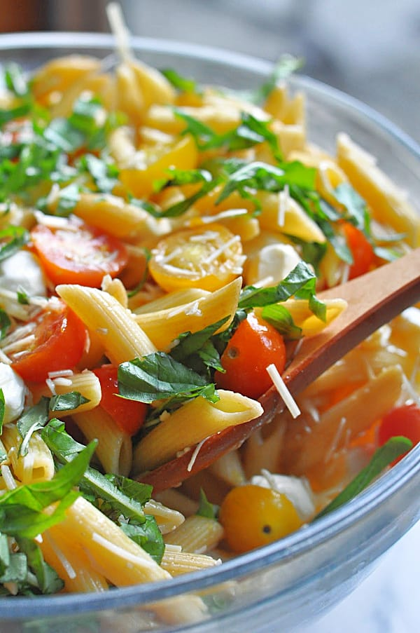 Caprese pasta salad recipe is an easy make-ahead dish for weeknight dinner or potlucks. Made with basil, mozzarella, tomatoes, and balsamic glaze.